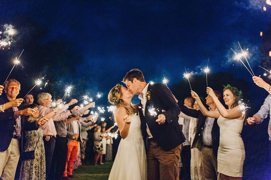 Bride and Groom Kissing with wedding sparklers