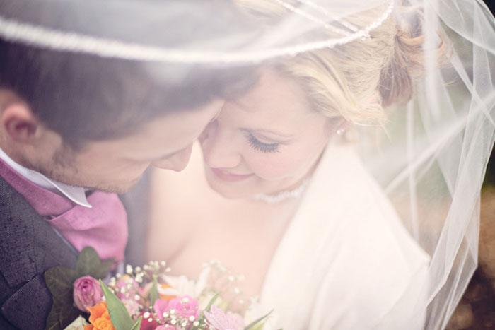wedding photography- bride and groom on a rainy day