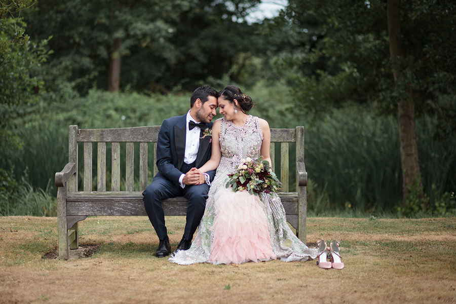 Bride and Groom sat on a bench in London park