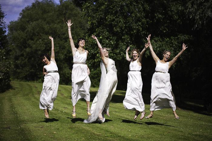 wedding photography of Bride Jumping with Bridesmaids