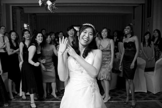 Bride throwing flowers - wedding photography
