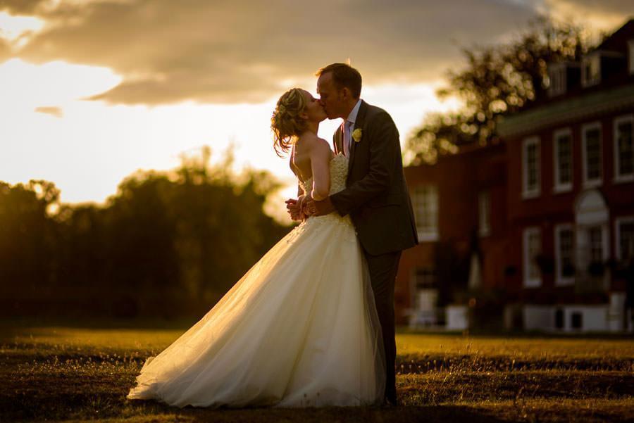Kissing at Sunset - Wedding Photography
