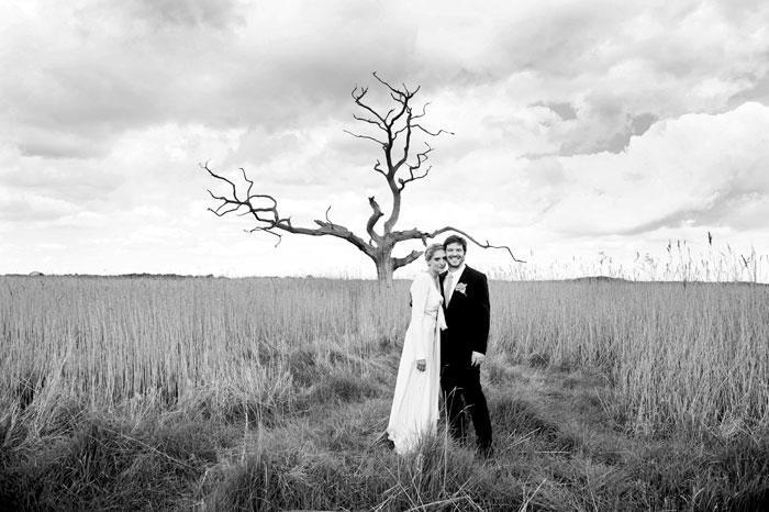 Wedding Photo - Bride and Groom in moody landscape