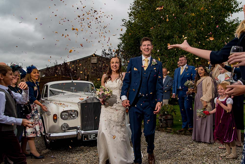 Confetti thrown at Bride and Groom at wedding in Devon