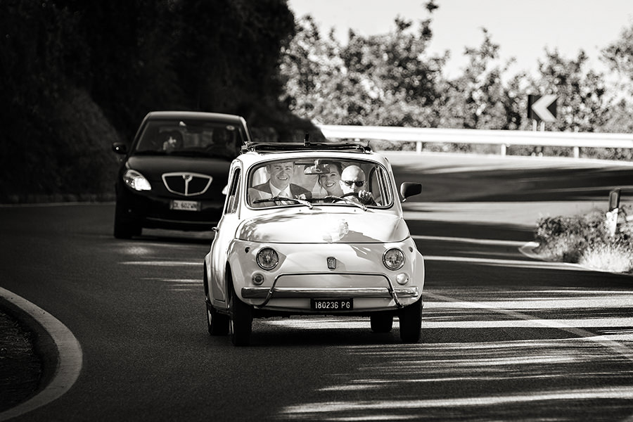 Bride and Groom in a Fiat 500., Tuscany