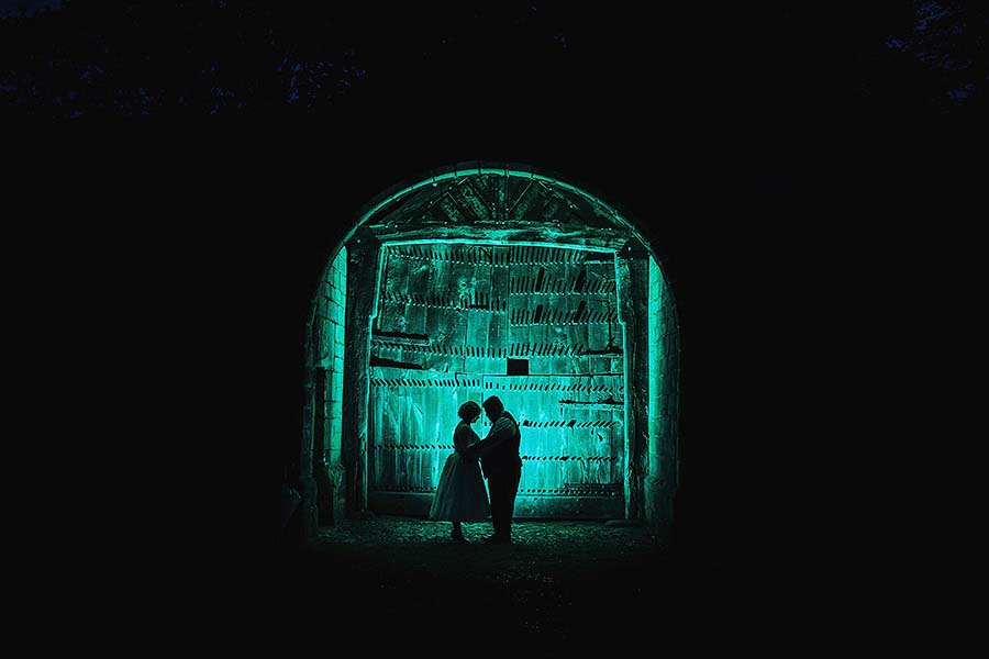 Bride and Groom in a Green Barn at Night